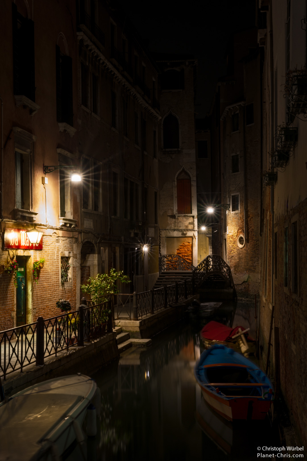 Boats floating in a water valley of Venice in the dark